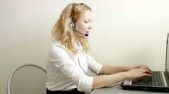 Pretty blond  woman at call center customer service Stock Footage