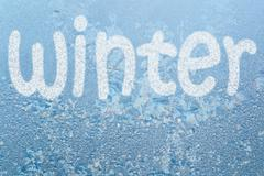 frost pattern and word winter - stock illustration