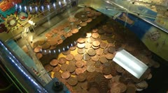 Coin push machine in amusement arcade - stock footage