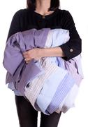 Stock Photo of woman holding shirt in hand