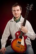 Man with a guitar Stock Photos