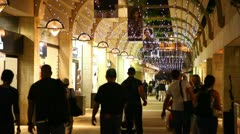 Tourists and locals enjoy a stroll in Mamilla open shopping mall Stock Footage