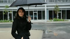Waiting in the rain. Wide shot. - stock footage