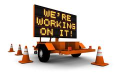 We're Working On It! - Construction Sign - stock illustration