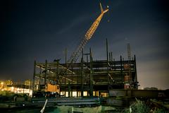 Building Construction Site With Crane (Night) - stock illustration