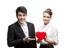 young happy business people holding red valentine - stock photo