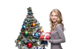 Stock Photo of young smiling woman holding christmas gift