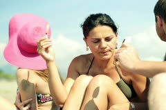 Group of friends eating ice lolly on the beach Stock Footage