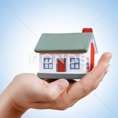 Stock photo of home in human hand