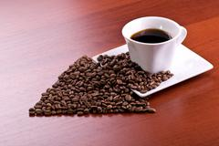 Cup of coffee and arrow Stock Photos