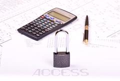 Padlock, pen, calculator and inscription access Stock Photos