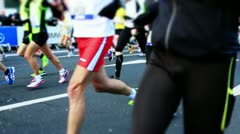 Marathon runner after start Stock Footage