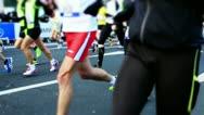 Marathon runner after start Stock Footage