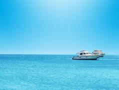 Beautiful mediterranean seascape and yacht on horizon Stock Photos