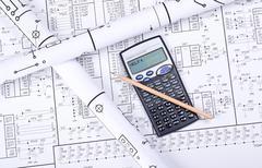 Blueprint crosswise and calculator Stock Photos