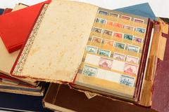 philatelic stamp collection albums - stock photo