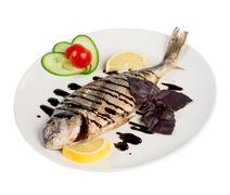 roast fish on the white - stock photo