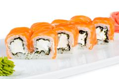 sushi (roll unagi maki syake) on a white background - stock photo