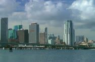 Plane flies over downtown Miami skyline in early morning Stock Footage