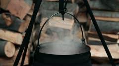 Tomato juice pouring into boiling cauldron Stock Footage