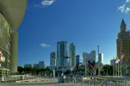 Stock Video Footage of Miami downtown skyline seen along Biscayne blvd from arena in late afternoon