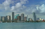 Stock Video Footage of Miami downtown skyline seen from across Biscayne bay in early morning