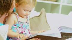 Mother Daughter Enjoying Photograph Album Close Up Stock Footage