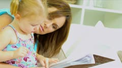 Young Mother Daughter with Photo Album Close Up Stock Footage