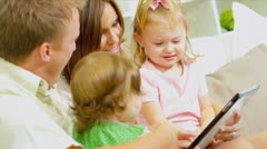 Little Girls Playing Digital Games with Parents Stock Footage