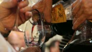 Pouring wine from decanter Stock Footage