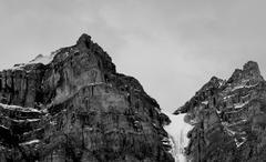 Glacier Cuts Through Mountain Pass - stock photo