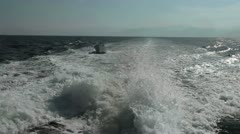 Wake behind ship towing small fishing boat Pacific Ocean HD 0662 Stock Footage