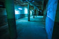 Abandoned warehouse lit blue Stock Photos