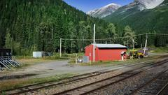 Red Train House In Mountains - stock photo