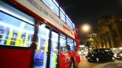 Red London bus and taxis at Night, trafalgar square, London Stock Footage
