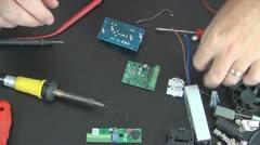 Worker Repairing an Electronic Board, Modifying an Electronic Board, Soldering  Stock Footage