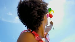 Young Ethnic Female Playing Toy Windmill Stock Footage