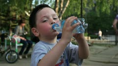 Little  boy drinks water Stock Footage