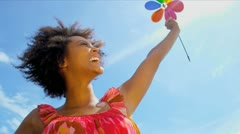 Beautiful Ethnic Female Toy Pin Wheel Outdoors Stock Footage