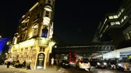 Narrow Pub on corner with passing traffic in London Stock Footage