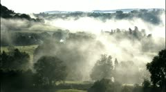 Morning mist over valley, T/L Stock Footage