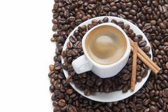 cup of coffee on a white surface. - stock photo
