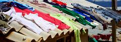 Clothes drying in the sun - stock photo