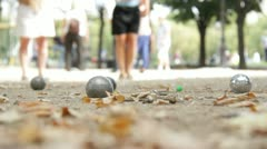 Women play boules in Paris Stock Footage