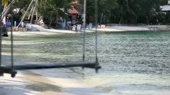 Beautiful beach with swing tied up to the tree on the sea shore. Stock Footage