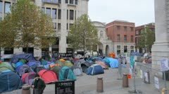 Occupy London tent city pan Stock Footage