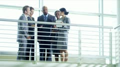 Ethnic business management team on atrium Stock Footage