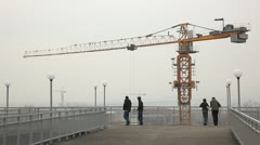 Tower cranes & people - stock footage