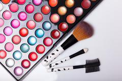 Colorful lip gloss palette with set of brushes Stock Photos