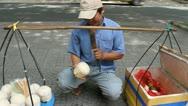 Man sells coconut in Vietnam Stock Footage